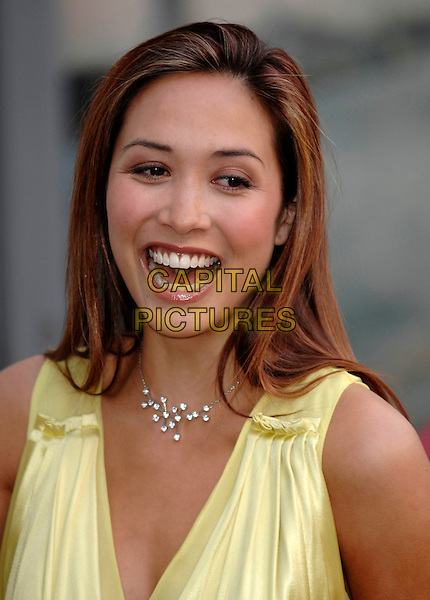 MYLEENE KLASS.pre-BAFTA photocall, Royal Opera House, Covent Garden, London, England..6th February 2007.headshot portrait yellow necklace mouth open.CAP/PL.©Phil Loftus/Capital Pictures