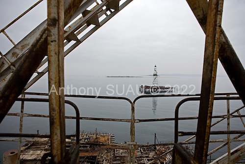 Baku, Azerbaijan .December 13, 2006..An off-shore oil rig run by SOCAR, the State Oil Company of Azerbaijan. It is, as most Azeri rigs are; old, out of date and rusted from top to bottom. It produces a small amount of oil for domestic market. ..Since British Petroleum has come on line with its' rigs in Azerbaijan there is now more funding for repairs on these old rigs and the worker's pay has slightly increased.