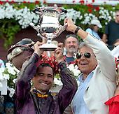 Corey Nakatani and Robert LaPenta hoist the Forego trophy.