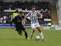 Doug Imrie under pressure from Anthony Watt in the St Mirren v Celtic Clydesdale Bank Scottish Premier League match played at St Mirren Park, Paisley on 20.10.12.