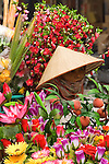 Street hawker selling artificial flowers, Luong Van Can St, Hanoi Old Quarter, Viet Nam