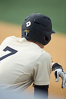 Kevin Conway (7) of the Wake Forest Demon Deacons waits for his turn to hit during the game against the Harvard Crimson at David F. Couch Ballpark on March 5, 2016 in Winston-Salem, North Carolina.  The Crimson defeated the Demon Deacons 6-3.  (Brian Westerholt/Four Seam Images)