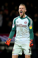 Brentford goalkeeper, Daniel Bentley, celebrates their 1-0 victory at the final whistle during Brentford vs Aston Villa, Sky Bet EFL Championship Football at Griffin Park on 13th February 2019