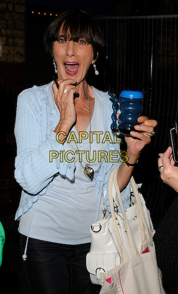 "JUNE BROWN .Seen leaving the theatre after the evening performance of ""Calendar Girls"", Noel Coward Theatre, London, England, UK, August 11th 2009..half length drink blue cup cardigan mouth open funny silver heart necklace top hand .CAP/CAN.©Can Nguyen/Capital Pictures"