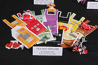 Tea-Bag origami by Tomoaki Ono. Each small piece is folded from a paper Japanese teabag envelope.