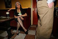 Fans of the cult Irish sitcom Father Ted, let their hair down in the pub in Kilfenora, Co. Clare, west of Ireland, Tuesday, February 26, 2008, during the annual Ted Festival. <br />