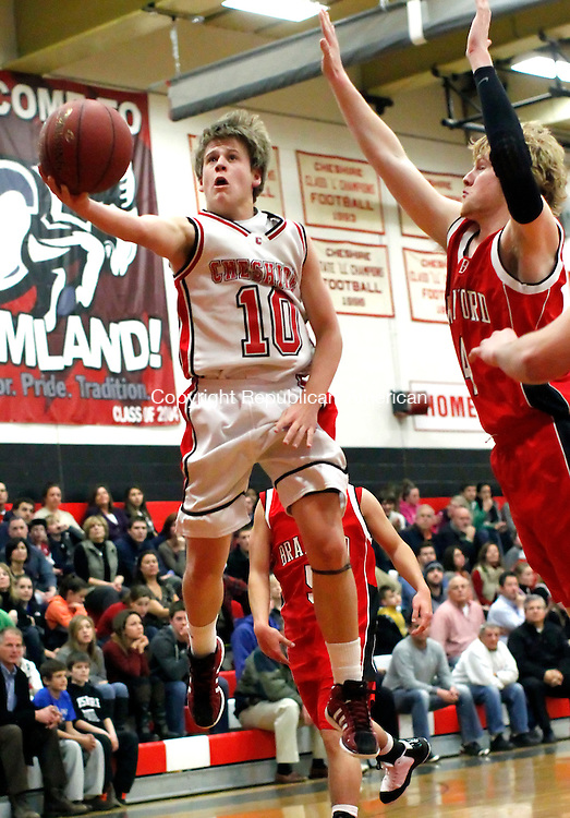 Cheshire, CT-20 January 2012-012012CM08  Cheshire's Collin Jordan (10) glides to the basket as  Branford's Zachary Cast jumps in to defend Friday night in Cheshire.     Christopher Massa Republican-American