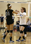 Marymount's Emileigh Rettig and Cassidie Watson get ready for a college volleyball game, in Arlington, Vir., on Saturday, Nov. 1, 2014.<br /> Photo by Cathleen Allison