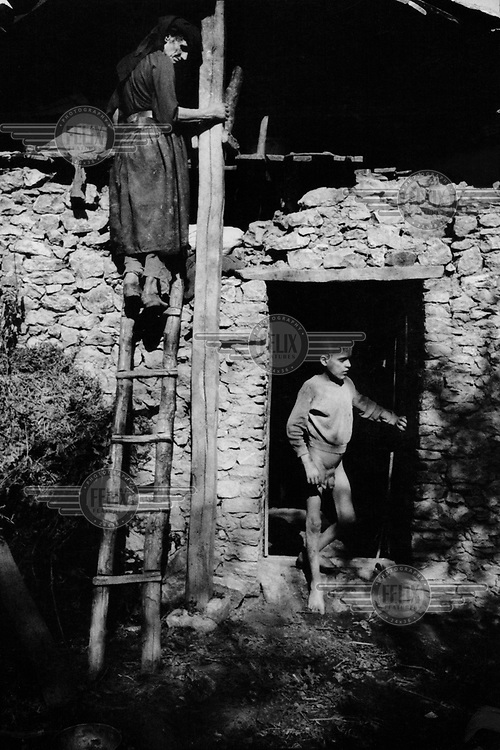 One of three mentally disabled brothers living in an outhouse with their mother, goats and pigs. After its downfall, the communist regime left the region in abject poverty....