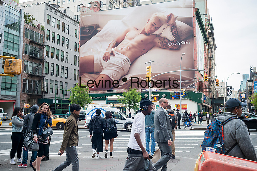 A Calvin Klein underwear billboard in the Soho neighborhood of New York features model/musician Justin Bieber on Tuesday, May 10, 2016.  (© Richard B. Levine)