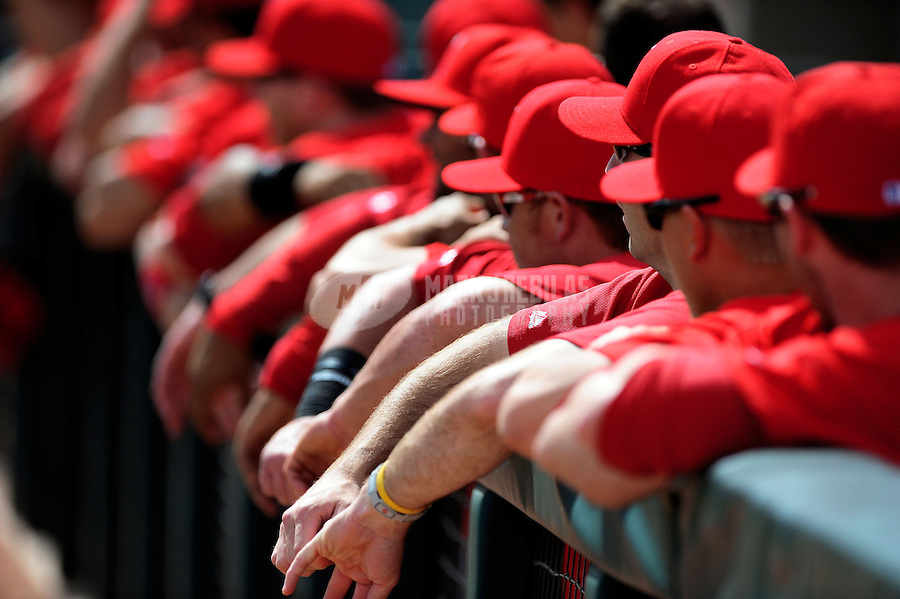 Mar. 4, 2012; Phoenix, AZ, USA; Los Angeles Angels players in the dugout in the first inning against the Oakland Athletics during a spring training game at Phoenix Municipal Stadium.  Mandatory Credit: Mark J. Rebilas-