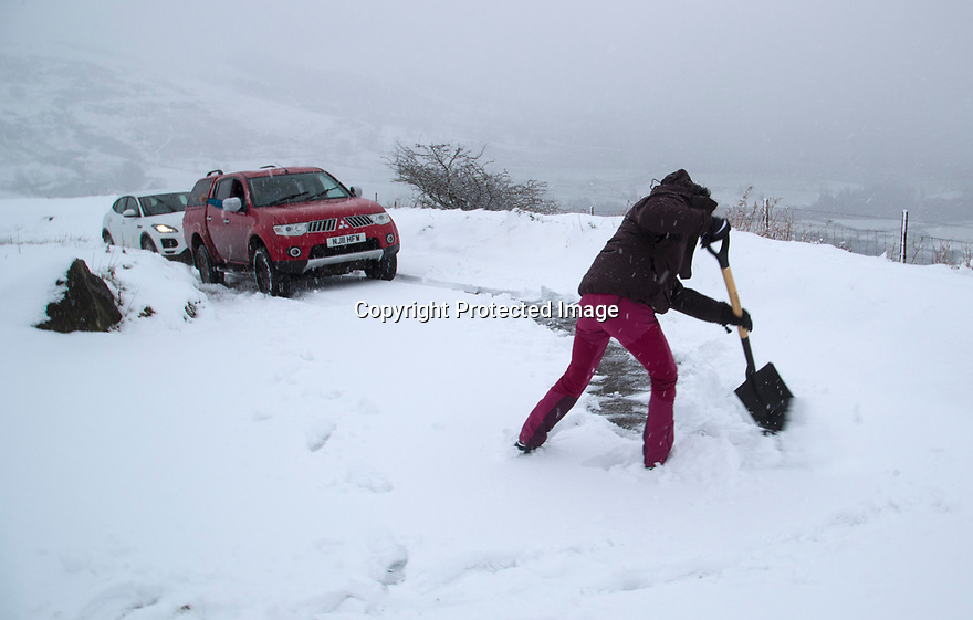 22/01/19<br /> <br /> Holly Rees digs tracks into the snow to give her 4x4 pick more traction before towing a stuck Jaguar near to Mam Tor and near Castleton in the Derbyshire Peak District.<br /> <br /> All Rights Reserved, F Stop Press Ltd +44 (0)7765 242650  www.fstoppress.com rod@fstoppress.com
