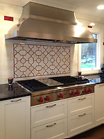 This custom kitchen designed by Cindy Leff for Fancy Fixtures features a Chatham 3 mosaic backsplash shown in Quartz and Ruby jewel glass.<br /> <br />  For pricing samples and design help, click here: http://www.newravenna.com/showrooms/