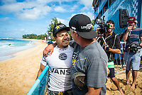 SUNSET BEACH, Oahu/Hawaii (Friday, December 5, 2014): Keanu Asing (HAW) with father Tommy Asing (HAW). The Vans World Cup of Surfing was  called ON this morning with competition begining with Round 4. <br /> A new NW 6 - 8 foot swell was on hand for the final which built through the day to 10 foot plus by the afternoon.<br /> Four island boys reached the final, three from the islands of Hawaii and one from the islands of tahiti. By the final hooter it was the Tahitian Michel Bourez (PYF) who emerged vitreous with Dusty Payne (HAW) 2nd, Sebastien Zietz (HAW) 3rd and Ian Walsh (HAW) 4th. Photo: joliphotos.com