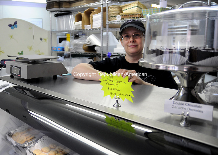 THOMASTON, CT, 01 JUN 12-060112AJ01- Dawn Sanford Miller who grew up in Thomaston and now lives in Bristol has opened a bakery on East Main Street in her hometown. Dawn's Desserts specializes in cookies, cupcakes brownies and cakes.  Alec Johnson/ Republican-American