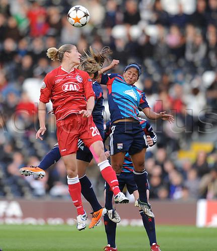 26.05.2011 Womens Champions League Final from Craven Cottage in London. FFC Turbine Potsdam v Olympique Lyonnais. Lyonnaise won 2-0. Potsdams Schmidt wins an aerial challenge