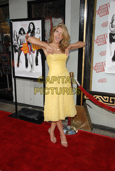 "CAMERON GOODMAN.Los Angeles Premiere of ""John Tucker Must Die"" held at The Grauman's Chinese Theatre in Hollywood, California  .July 25th, 2006.Ref: DVS.full length yellow strapless dress funny arms.www.capitalpictures.com.sales@capitalpictures.com.©Debbie VanStory/Capital Pictures"