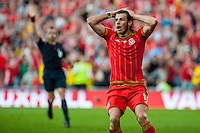Gareth Bale  of Wales  holds his hands in his heads after his goal is disallowed during their UEFA EURO 2016 Group B qualifying round match held at Cardiff City Stadium, Cardiff, Wales, 06 September 2015. EPA/DIMITRIS LEGAKIS