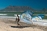 Cape Town, South Africa, September 2011. Kite Surfing on Blaauwberg Strand Beach. Travelling by camper is a great way to see the Cape Winelands, Klein Karoo, and the Garden Route. The Garden Route offers you majestic mountains, breathtaking views, a natural garden of rich, colourful vistas, with valleys and lakes, rivers and forests, a paradise for bird-lovers and nature lovers, an eco-destination like few others in the world, with miles upon miles of beautiful, white sandy beaches.  Photo by Frits Meyst/Adventure4ever.com