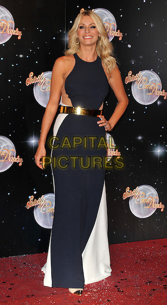 Tess Daly.The Strictly Come Dancing 2012 Launch at the BBC, Wood Lane, London, England..September 11th, 2012 .full length black white dress hand on hip gold belt.CAP/WIZ.© Wizard/Capital Pictures.