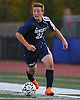 Hewlett No. 22 Alexander Vardaro moves the ball downfield during a Nassau County varsity boys' soccer game against host Manhasset High School on Thursday, October 15, 2015. Manhasset won by a score of 2-0.<br /> <br /> James Escher