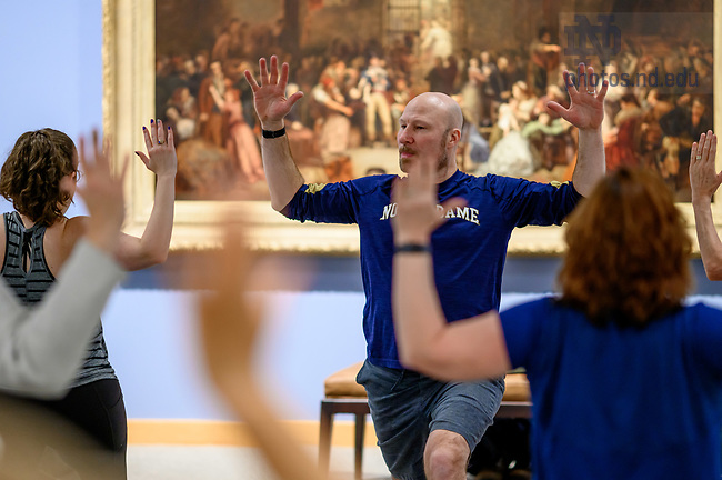 "February 6, 2020; Notre Dame RecSports Yoga instructor Steve Krojniewski (aka: 'Yoga Steve') leads participants in the monthly ""Yoga in the Gallery"" in the Snite Museum of Art. (Photo by Matt Cashore/University of Notre Dame)"