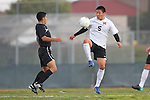Torrance, CA 02/23/11 - Ludwing Vargas (Salesian #5) and Justin Kim (Bishop Montgomery #5) in action during the second round CIF playoffs between Bishop Montgomery and Salesian.