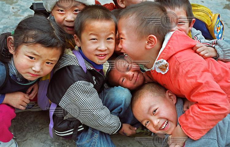 Children play in the schoolyard of a school for children of migrant workers.