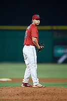 Clearwater Threshers relief pitcher Jeff Singer (24) gets ready to deliver a pitch during a game against the Jupiter Hammerheads on April 9, 2018 at Spectrum Field in Clearwater, Florida.  Jupiter defeated Clearwater 9-4.  (Mike Janes/Four Seam Images)