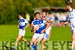 Rahillys David Moran been tackled by Sean Sheehan of Templenoe in the Senior Club football championship