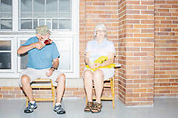 Ron and Sue Comer, of Bloomfield, Iowa, sit on the Administration Building porch on a rainy day at the Iowa State Fair in Des, Moines, Iowa, on Sun., Aug. 11, 2019.