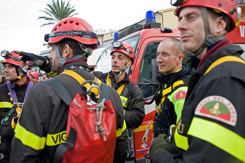 Isola del Giglio, Italy, January 19, 2012. Firemen squad get ready before searching the cruise liner Costa Concordia aground in front of the harbour of the Isola del Giglio (Giglio island) after hitting underwater rocks.