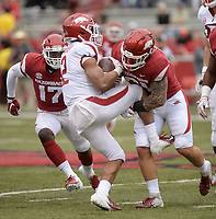 NWA Democrat-Gazette/ANDY SHUPE<br /> Arkansas running back Chase Hayden (2) is tackled by linebacker Grant Morgan (right)  as defensive back Joe Foucha (17) closes in on the play Saturday, April 6, 2019, during the Razorbacks' spring game in Razorback Stadium in Fayetteville. Visit nwadg.com/photos to see more photographs from the game.