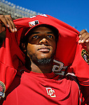 23 September 2007: Washington Nationals outfielder Wily Mo Pena removes his game jersey preparing for a post-game ceremony commemorating the last professional baseball game played at Robert F. Kennedy Memorial Stadium in Washington, DC. The Nationals defeated the visiting Philadelphia Phillies 5-3 to close out the 2007 season at RFK Stadium.. .Mandatory Photo Credit: Ed Wolfstein Photo