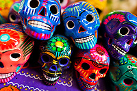 Colorful painted skulls (Calaveras) are sold on the market during the Day of the Dead holiday in Mexico City, Mexico, 28 October 2016. Skulls, skeletons and the other death symbols are used to adorn graves, altars and offerings during the Day of the Dead (Día de Muertos). A syncretic religious holiday, combining the death veneration rituals of the ancient Aztec culture with the Catholic practice, is celebrated throughout all Mexico. Based on the belief that the souls of the departed may come back to this world on that day, people gather at the gravesites in cemeteries, praying, drinking and playing music, to joyfully remember friends or family members who have died and to support their souls on the spiritual journey.