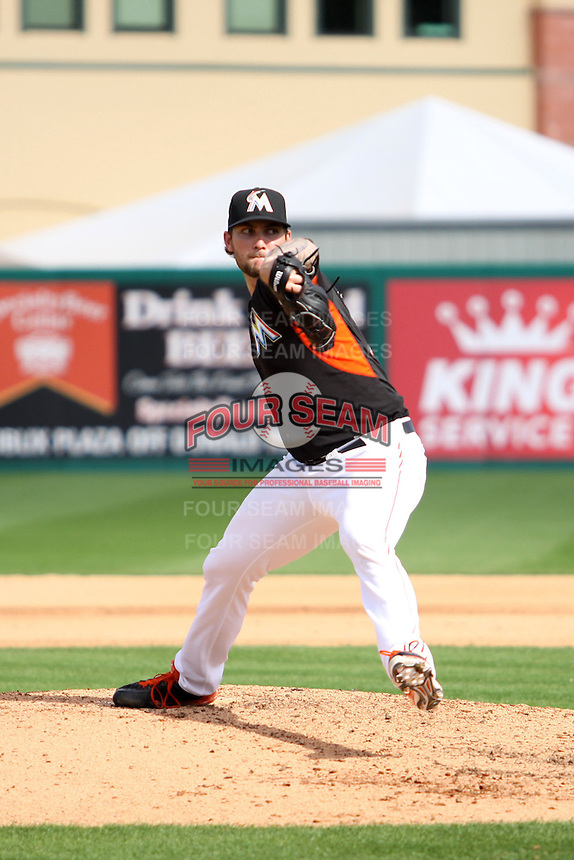 Trevor Williams (79) throws a pitch for the Miami Marlins during a spring training game against the University of Miami Hurricanes at the Roger Dean Complex in Jupiter, Florida on March 3, 2015. Miami defeated UM 7-1. (Stacy Jo Grant/Four Seam Images)