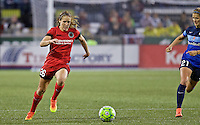 Portland, Oregon - Saturday July 9, 2016: Portland Thorns FC forward Mallory Weber (26) dribbles the ball in front of FC Kansas City defender Katie Bowen (21) during a regular season National Women's Soccer League (NWSL) match at Providence Park.