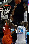 30 December 2015: Clemson's Jaron Blossomgame (5) blocks a shot by North Carolina's Joel James (42). The University of North Carolina Tar Heels hosted the Clemson University Tigers at the Dean E. Smith Center in Chapel Hill, North Carolina in a 2015-16 NCAA Division I Men's Basketball game. UNC won the game 80-69.
