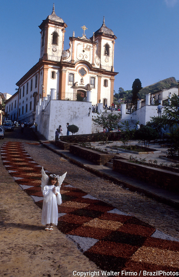 Easter celebration, children dressed as angels, street carpet made of painted rice. Ouro Preto is a city in the state of Minas Gerais, Brazil, a former colonial mining town located in the Serra do Espinhaço mountains and designated a World Heritage Site by UNESCO because of its outstanding Baroque architecture.