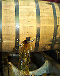 After aging for nine years, Knob Creek bourbon pours out of the barrel, where it will be blended with other Knob Creek bourbon that has aged. The black residue represent the char from within the barrels, but are filtered out. Knob Creek is a part of the Jim Beam family of bourbons produced in Claremont, Ky.