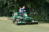Groundsman cutting the grass,  State Secondary Roman Catholic school.