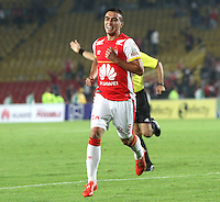 BOGOTA - COLOMBIA - 24-03-2015: Dario Rodriguez jugador de Independiente Santa Fe celebra su gol contra el Deportivo Independiente Medellin, durante partido aplazado por la fecha 6 entre Independiente Santa Fe y Deportivo Independiente Medellin de la Liga Aguila I-2015, en el estadio Nemesio Camacho El Campin de la ciudad de Bogota. / Dario Rodriguez  player of Independiente Santa Fe celebrates his goal against of Independiente Medellin, during a postponed match of the 6 date between Independiente Santa Fe and Deportivo Independiente Medellin for the Liga Aguila I -2015 at the Nemesio Camacho El Campin Stadium in Bogota city, Photo: VizzorImage / Felipe Caicedo / Staff.