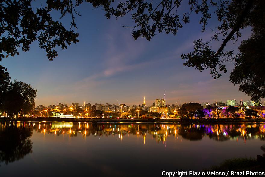 Ibirapuera Park ( Parque Ibirapuera) a major urban park with Sao Paulo cityscape at night in background, Brazil..