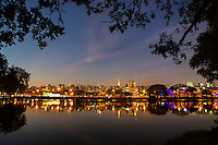 Ibirapuera Park ( Parque Ibirapuera) a major urban park with Sao Paulo cityscape at night in background, Brazil..
