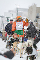 Kelly Maixner leaves the 2011 Iditarod ceremonial start line in downtown Anchorage, during the 2012 Iditarod..Jim R. Kohl/Iditarodphotos.com