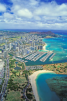 Great aerial shot of Magic Island, Ala Moana Beach park, Waikiki hotels and beach and Diamond Head in the distance. Great contrast of white sand rimming the beautiful Pacific ocean.