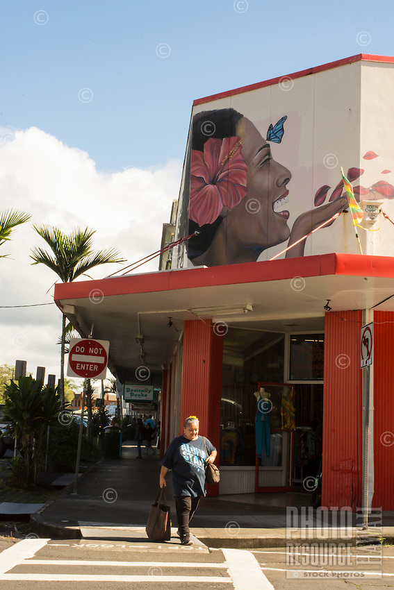 A local woman crosses the street outside the King Kamehameha Market building in Hilo, Big Island of Hawai'i.