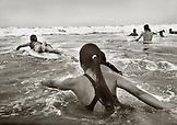 USA, California, Santa Monica, a group of Jr. Lifeguards train in the ocean near the Santa Monica Pier (B&W)