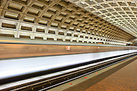 A subway train streaks through the Farragut West station of the Washington DC metro.