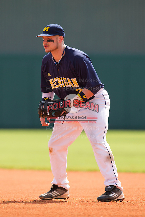 Michigan Wolverines first baseman Coley Crank #3 during a game against the Seton Hall Pirates at the Big Ten/Big East Challenge at Al Lang Stadium on February 18, 2012 in St. Petersburg, Florida.  (Mike Janes/Four Seam Images)